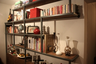Bespoke shelving unit in painted steel and walnut stained ply